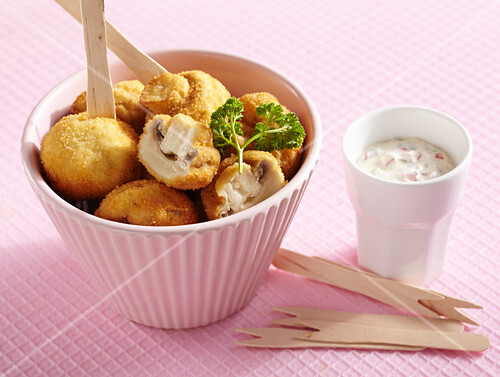 Breaded, crispy fried mushrooms with a vegetable dip made from mayonnaise and yoghurt