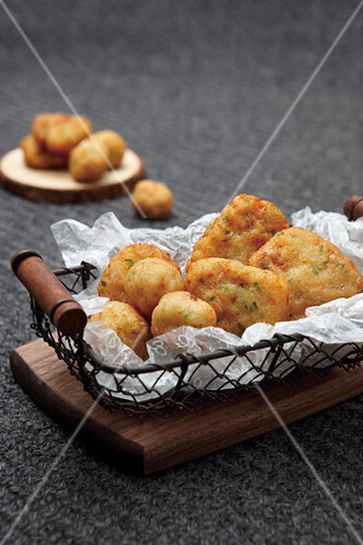 Fried fish balls and fish fritters in wire baskets (Asia)