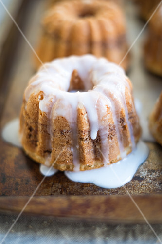 Two coffee cakes with almonds and icing