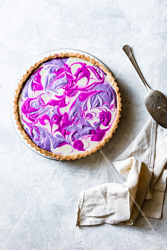 A marbled dragon fruit and purple beet tart