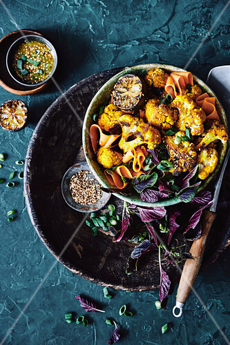 Roasted cauliflower coated in an Asian inspired turmeric, lemongrass and shallot marinade, mixed with a salad of asian greens, thin sliced cooked sweet potatoes, shallots and toast sesame seeds