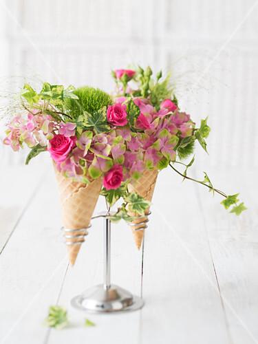 Roses and hortensias arranged in ice cream cones