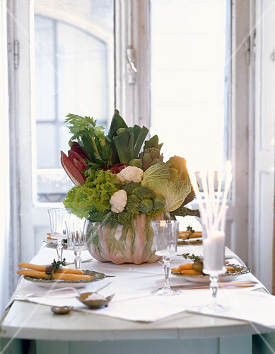 Attractive arrangement of vegetables in bowl on table