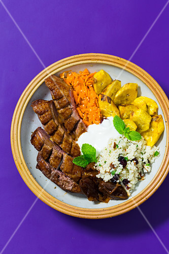 Africa bowl with duck, plantains and tamarind