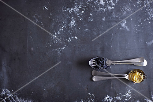 Black and white Spaghetti on spoon and fork