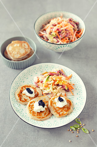 Blini with sour cream, caviar and presidential salad (Russia)