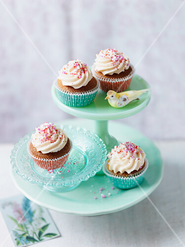 Cupcakes with buttercream and red sugar pearls