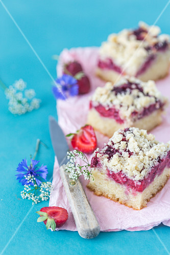 Slices of a vegan strawberry yeast cake on a plate