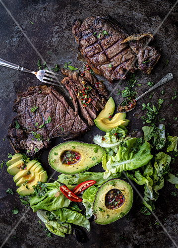 Thai steak salad with avocados on a platter