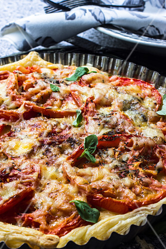 Tomato tart with basil in a tart tin