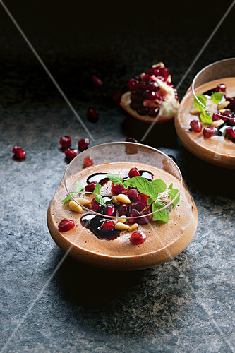 Choc mousse with pine nuts and pomegranate
