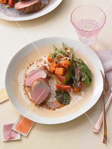Pork tenderloin in pancetta with sweet potatoes