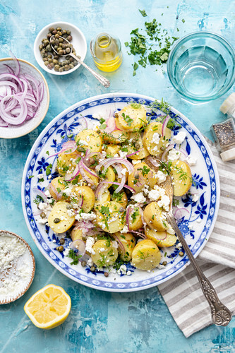 Greek potato salad with red onions and feta
