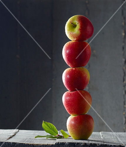 Red apples stacked in a tower