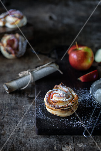 Puff pastry apple roses with powdered sugar