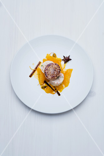 Sautéed foie gras and spiced jus with oranges