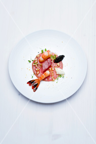 Yellow-tailed prawn and Sevruga caviar with walnuts and mirin rice wine dressing