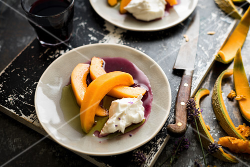 Ogen melon, served with soft goats cheese and a reduced red wine dressing flavoured with fresh lavender flowers