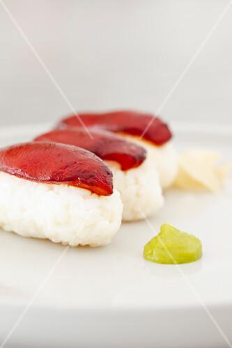 Vegan nigiri sushi with marinated soy tomatoes