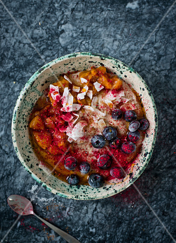 Millet with fruits, coconut and maple syroup