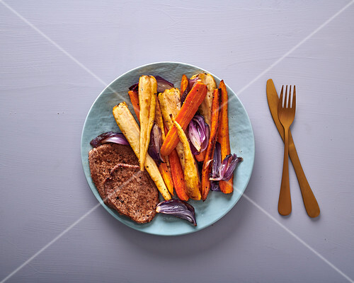 Lamb steaks with roasted carrots, parsnips & red onion
