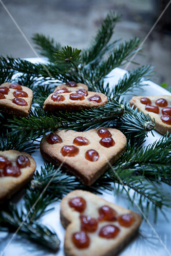 Gingerbread Christmas heart biscuits decorated with glace cherries