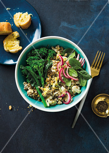 Creamy lentil and broccoli bowl with micro greens