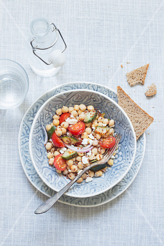 Tasty vegetarian dish served with bread and water