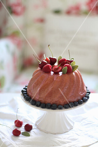 A Bundt cake with cherries and berries