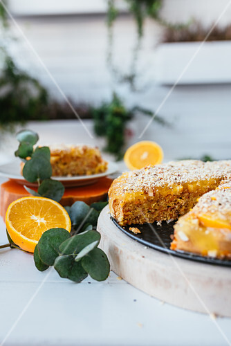 Pumpkin and oranges tart with one slice cut off