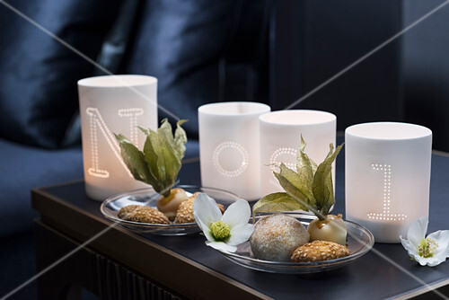 Candle lanterns with letters spelling Noel