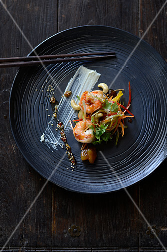 Wasabi prawns on a bed of oriental vegetables