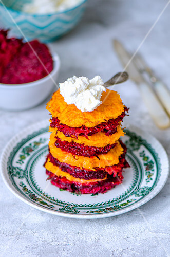 Carrot and beet patties stacked with ricotta