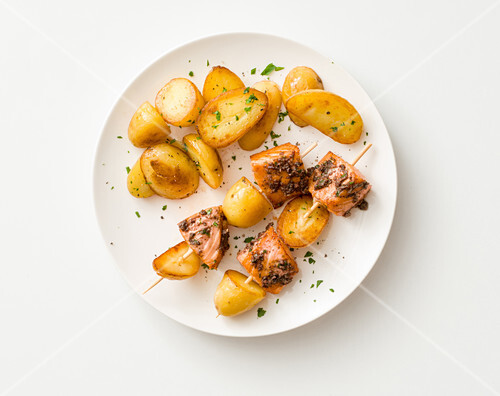 Potato and salmon skewers with olive paste