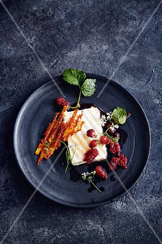 Grilled feta cheese with boysen berries and coriander flowers