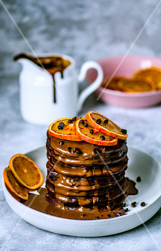 Chocolate pancakes with chocolate drops and chocolate sauce