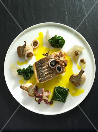 Mediterranean seabass with chard and calamaretti in a lemon sauce