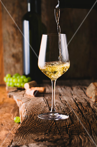 White wine pouring in a glass