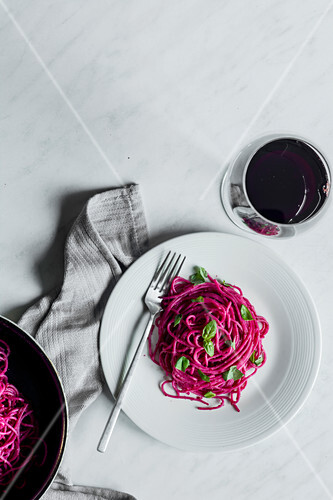 Spaghetti with beetroot pesto served with red wine