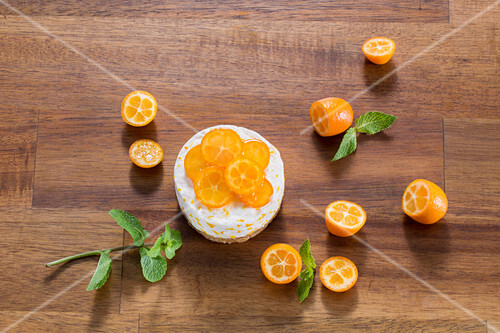 Orange tart decorated with kumquats
