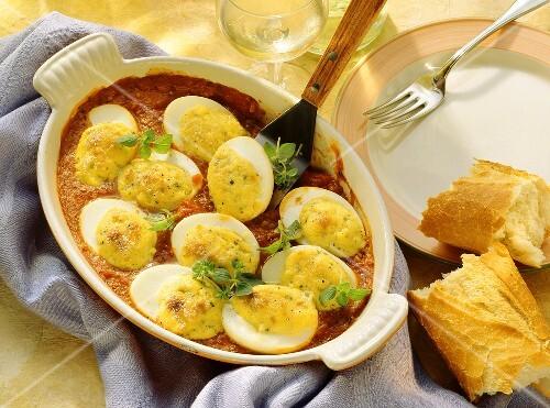 Gratin of gorgonzola & eggs on tomato sauce in gratin dish