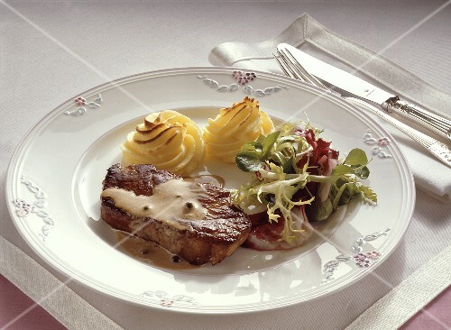 Beef Steak with Salad and Potatoes