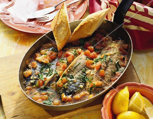 Mackerel with tomatoes in pan