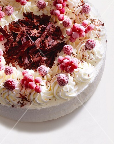 Raspberry ice cream cake with berries and chocolate curls