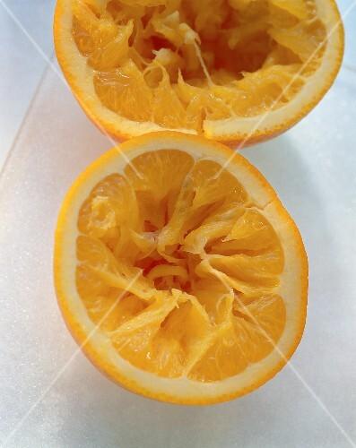 Two squeezed orange halves