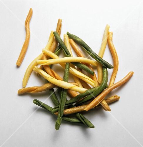 Strozzapreti tris (Rolled pasta in three colours)