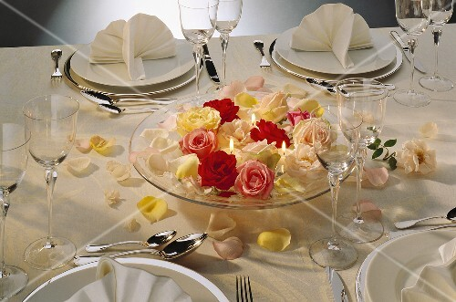 Formal Table Setting with a Centerpiece of Roses and Candles
