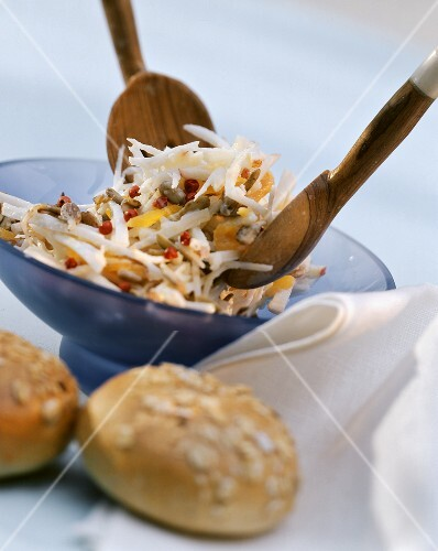 Celeriac salad with apple, apricots and pink pepper