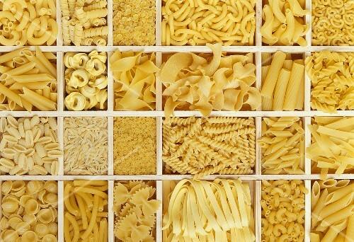 Still life: various types of pasta in white typesetter's case