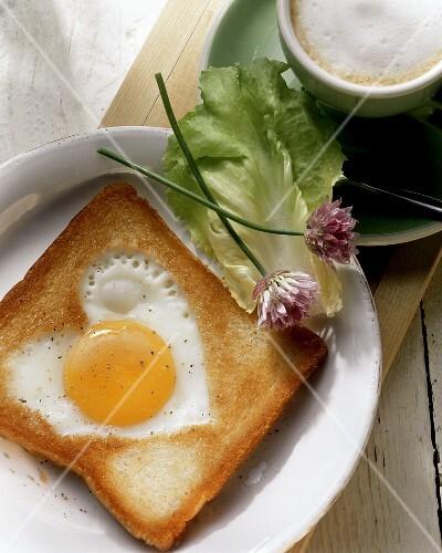 Heart-shaped fried egg on toast
